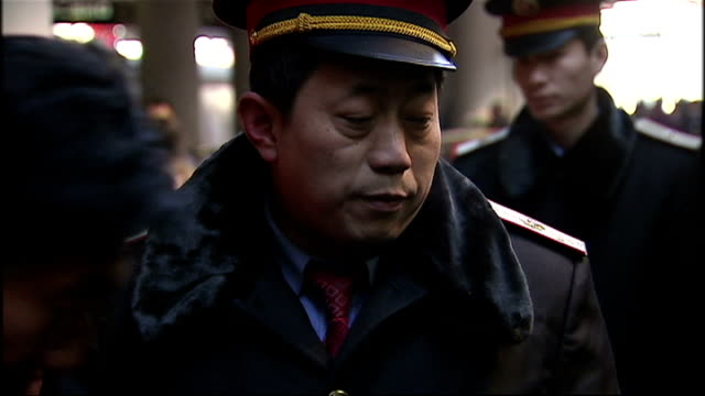 shows interior shots train staff on platform people boarding the train on january 17 2009 in beijing china - bahnreisender stock-videos und b-roll-filmmaterial