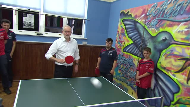 Shows interior shots UK Labour Party Leader Jeremy Corbyn playing table tennis with young people at a Brighton Table Tennis club The Labour party...