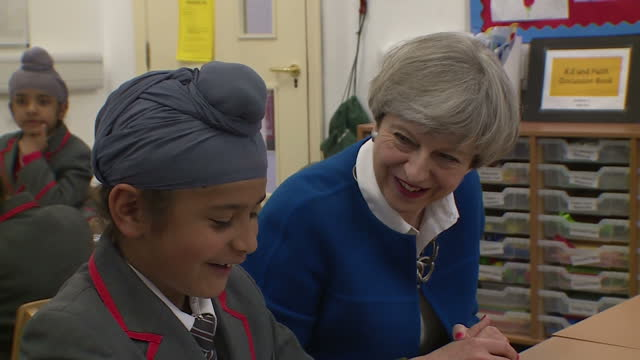 vídeos de stock, filmes e b-roll de shows interior shots uk prime minister and conservative candidate theresa may sitting in primary school classroom talking to students at nishkam... - primary election