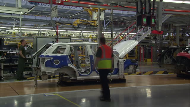 shows interior shots uk prime minister theresa may and chancellor philip hammond touring jaguar land rover car manufacturing plant with shots of cars... - impact stock videos and b-roll footage