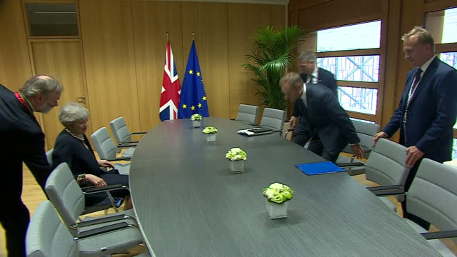 shows interior shots uk prime minister theresa may and eu council president donald tusk walking into room and sitting down to begin bilateral meeting... - theresa may stock videos & royalty-free footage