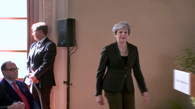 Shows interior shots UK Prime Minister Theresa May arriving for speech in Florence and peopl ein audience including Cabinet Ministers David Davis...