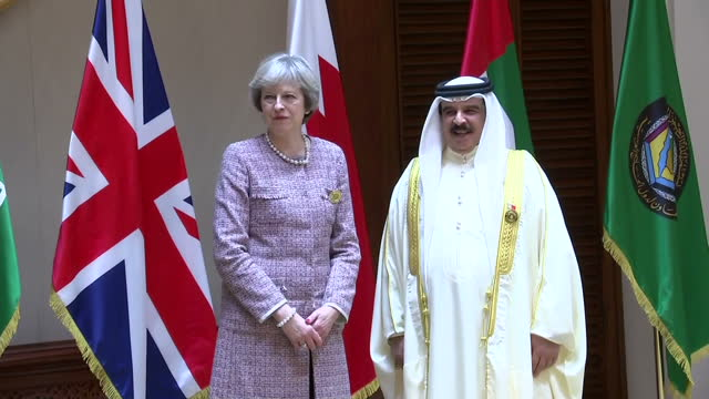 shows interior shots uk prime minister theresa may arriving for family photo, standing next to king of bahrain hamad bin isa al khalifa, and posing... - annual general meeting stock videos & royalty-free footage
