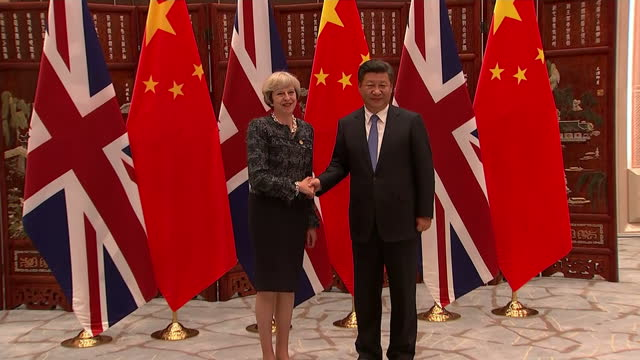 shows interior shots uk prime minister theresa may at g20 summit arriving for press conference shaking hands with world leaders including president... - group of 20 stock videos & royalty-free footage