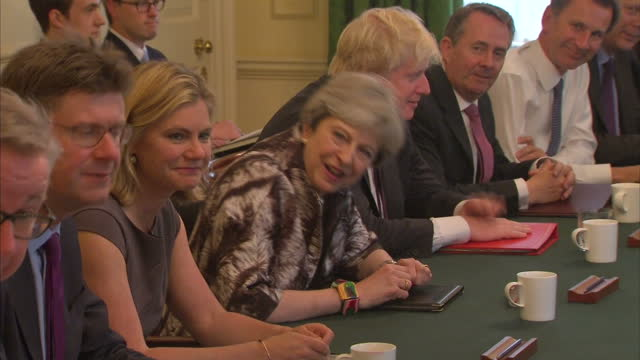 shows interior shots uk prime minister theresa may chairing a meeting of her cabinet ministers in downing street. theresa may's new cabinet is... - prime minister stock-videos und b-roll-filmmaterial