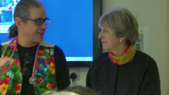 Shows interior shots UK Prime Minister Theresa May meeting hospital staff at Frimley Park Hospital and speaking to them thanking them for their work...