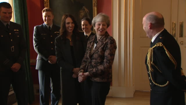 shows interior shots uk prime minister theresa may meeting with prime minister of new zealand jacinda ardern and military personnel in number 10... - prime minister stock-videos und b-roll-filmmaterial