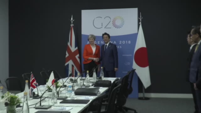 shows interior shots uk prime minister theresa may meeting with japanese prime minister shinzo abe at g20 summit theresa may is currently in... - group of 20 stock videos & royalty-free footage