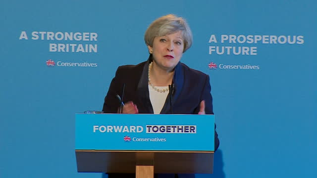 Shows interior shots UK Prime Minister Theresa May speech soundbite on Conservative values with shot to Senior Tories in front row of audience at...
