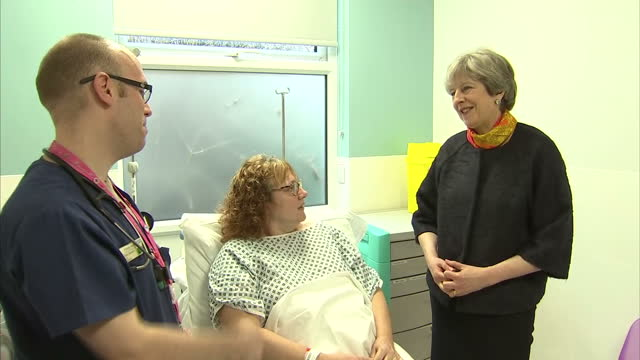 Shows interior shots UK Prime Minister Theresa May talking to patient in bed at Frimley Park Hospital The Prime Minister has apologised for cancelled...