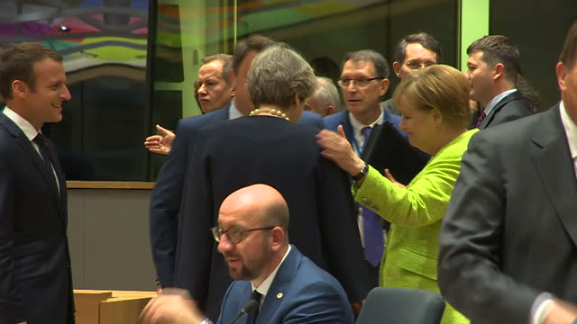 shows interior shots uk prime minister theresa may talking with eu leaders including german chancellor angela merkel and french president emmanuel... - angela merkel stock videos & royalty-free footage