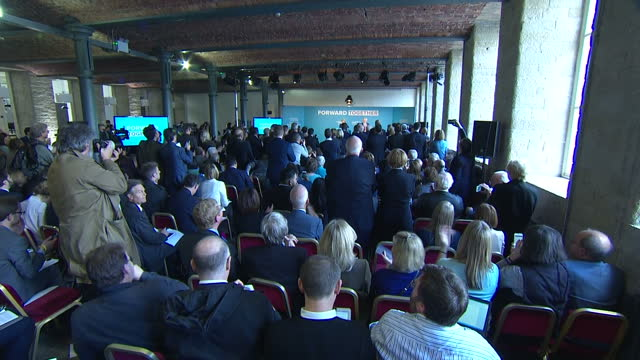 Shows interior shots UK Prime Minister Theresa May walking onto stage and acknowledging applause at Conservative Party Manifesto Launch Theresa May...