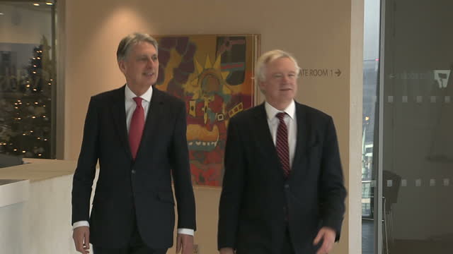 Shows interior shots UK's Chancellor Philip Hammond and UK's Secretary of State for Exiting the European Union David Davis arriving for and during...
