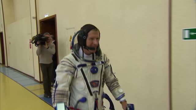 shows interior shots uk's esa astronaut tim peake in star city training centre near moscow, putting on spacesuit, getting into training module a... - image video stock e b–roll