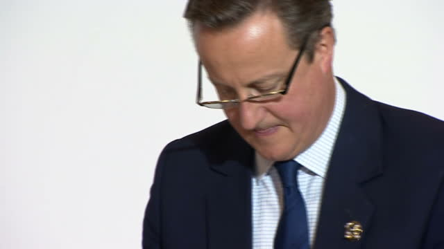 shows interior shots uk's prime minister david cameron writing and talking to various other world leaders including japanese prime minister shinzo... - g7サミット点の映像素材/bロール