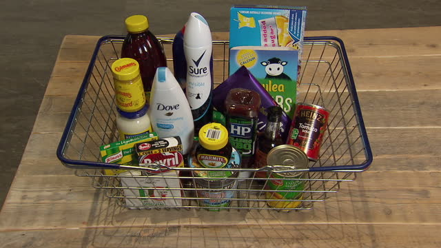 shows interior shots unilever and kraft heinz retail products being placed into shopping basket including colman's mustard dove sure marmite heinz... - kraft stock videos & royalty-free footage