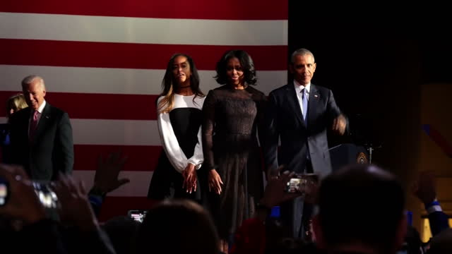 vídeos de stock, filmes e b-roll de shows interior shots us president barack obama waving from stage with his family after giving his final speech as us president. president obama was... - 2017