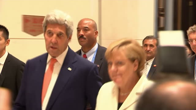 shows interior shots us secretary of state john kerry talking to german chancellor angela merkel as they walk into meeting room at g20 summit on... - hangzhou stock videos & royalty-free footage