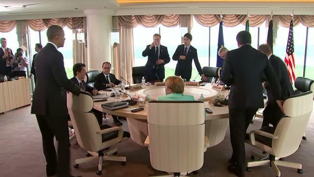 shows interior shots world leaders walking into room and sitting round table for discussions at g7 summit including italian prime minister matteo... - g7サミット点の映像素材/bロール