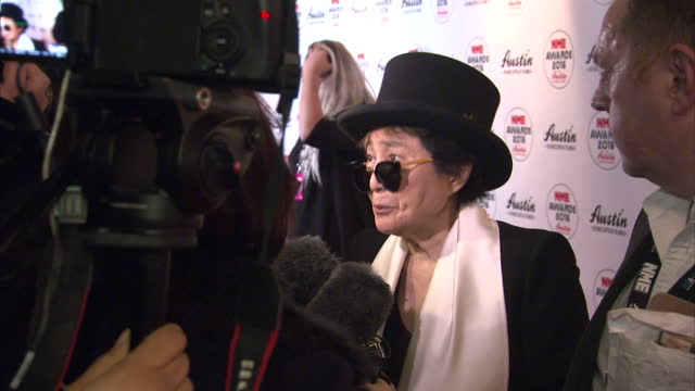 Shows interior shots Yoko Ono Widdow of John Lennon posing for photos and talking to press on the red carpet The NME Awards 2016 with Austin Texas...