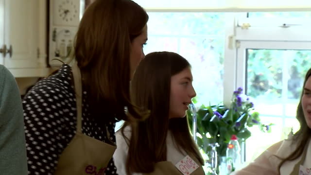 shows intterior shots catherine , duchess of cambridge talking to girls during a cooking lesson at savannah house, a residential facility run by... - organisation stock videos & royalty-free footage