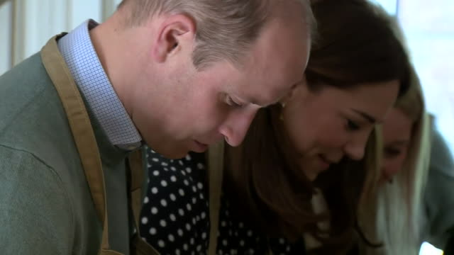 shows intterior shots prince william, duke of cambridge, and catherine , duchess of cambridge arriving, washing their hands and starting to peel... - cooking stock videos & royalty-free footage