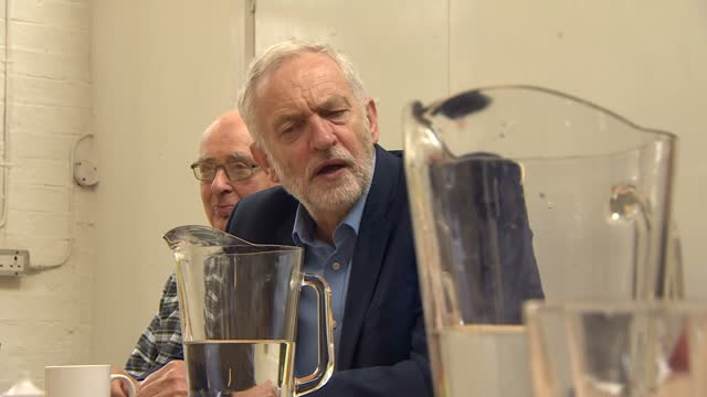 shows labour leader jeremy corbyn chatting to elderly people at a community centre in shipley west yorkshire on 12th october 2017 - west yorkshire stock-videos und b-roll-filmmaterial