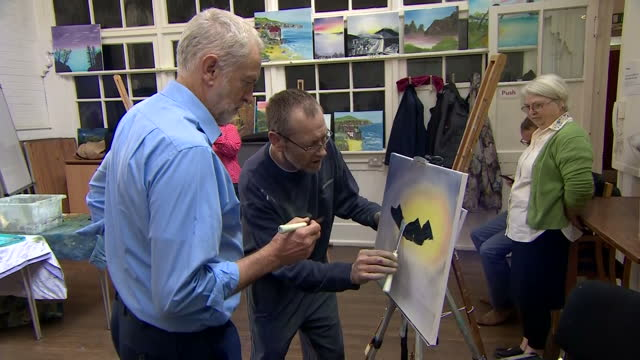 shows labour leader jeremy corbyn doing a spot of painting while on a visit to community centre in shipley west yorkshire on 12th october 2017 - west yorkshire stock-videos und b-roll-filmmaterial