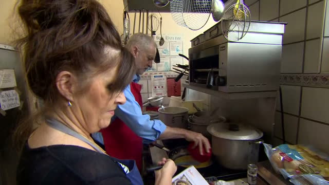 Shows Labour Leader Jeremy Corbyn helping with cooking at a community centre in Shipley West Yorkshire on 12th October 2017