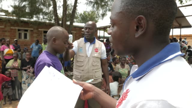 shows medical staff try to contain ebola outbreak in democratic republic of congo clip includes food sacks being distributed to villagers interview... - medical resident stock videos and b-roll footage
