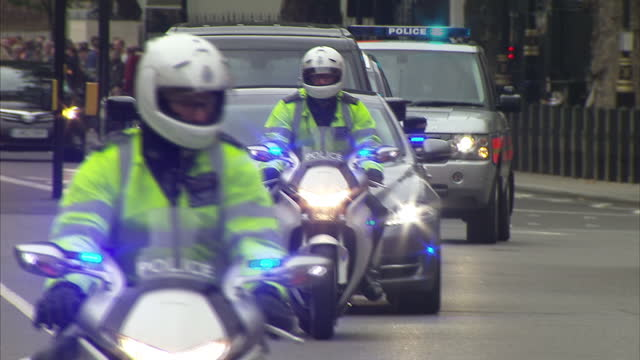 shows motorcade carrying british prime minister theresa may in whitehall london october 9th 2017 - motorcade stock videos & royalty-free footage