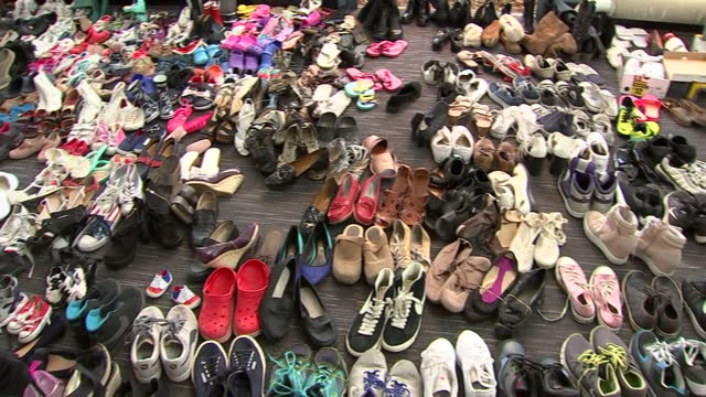shows pairs of shoes laid out in rows donated to survivors of the grenfell tower block fire survivors of the grenfell tower block fire in west london... - shoes in a row stock videos & royalty-free footage