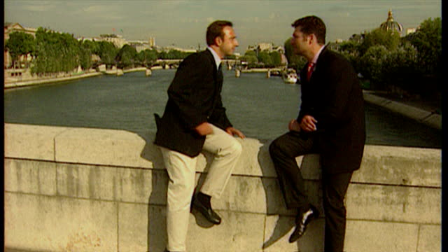 Shows Paris skyline Notre Dame and Paris streetscenes newspaper stand regarding Princess Diana Exterior interview with Stephane Bern Royal...