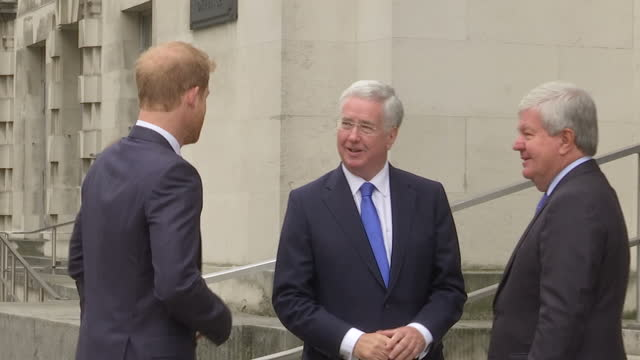 Shows Prince Harry arriving at the Ministry of Defence and being greeted by Sir Michael Fallon Secretary of State for Defence and the Chair of the...