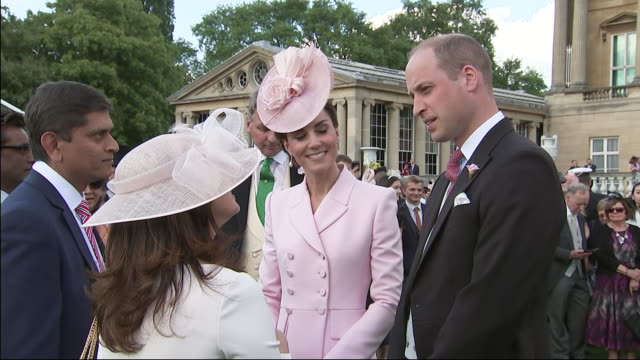 Shows Prince William Duke of Cambridge and Catherine Duchess of Cambridge chatting to guests at the Royal Garden Party at Buckingham Palace on May 21...