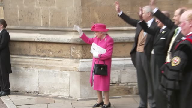 shows queen elizabeth ii and other royals guests outside st george's chapel waving off car carryng lady gabriella windsor and thomas kingston... - elizabeth ii stock videos & royalty-free footage