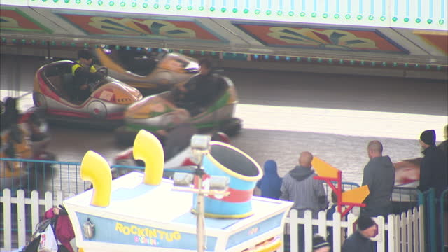 shows stock shots of butlin's holiday camp in bognor regis with shots of signage and various fairground rides in amusement park area. - holiday camp stock videos & royalty-free footage