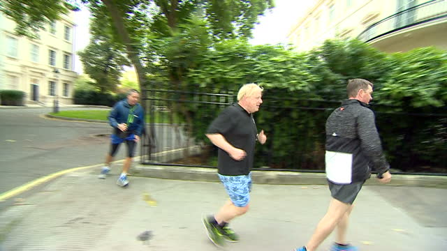 Shows UK Secretary of State for Foreign Affairs Boris Johnson jogging and ignoring questions about the stability of his position as Foreign Secretary...