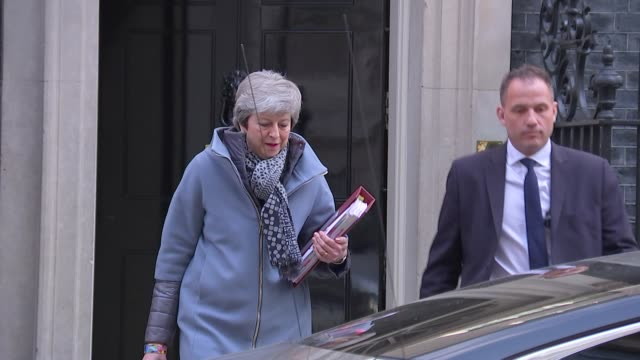 shows uk's prime minister theresa may leaving downing street as reporters shout questions at her. the prime minister is preparing to head to brussels... - prime minister's questions stock videos & royalty-free footage