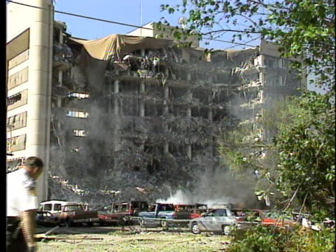 shredded metal debris dangles from blown out windows in the bombed murrah federal building. - oklahoma city bombing stock videos & royalty-free footage
