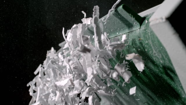 slo mo shredded paper falling from industrial shredder conveyor belt - recycling stock videos & royalty-free footage