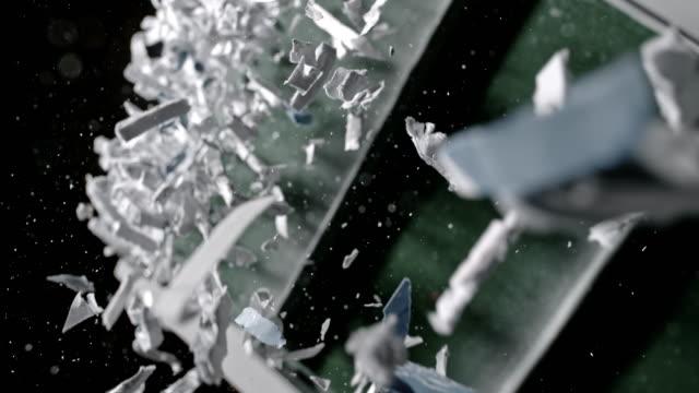slo mo zerkleinert papier herunterfallen förderband - 4k auflösung stock-videos und b-roll-filmmaterial