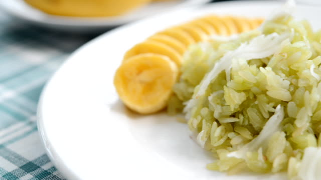 shredded rice grain with coconut flesh and banana thaifood - unripe stock videos and b-roll footage
