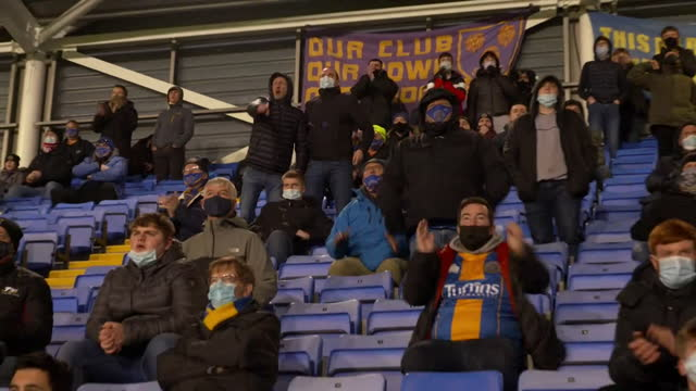 shrewsbury town football fans attend match at the meadows stadium, as fans were able to attend football matches for the first time since the... - attending stock videos & royalty-free footage