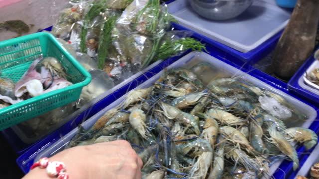 Shrimp picking , Choosing raw seafood for dinner , Pattaya , Thailand.