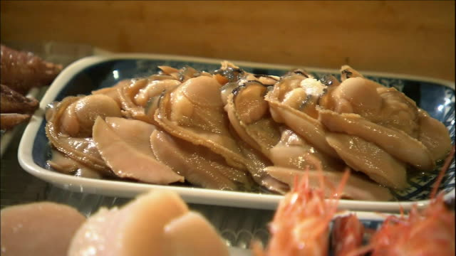 shrimp skewers fill a wooden tray. - nigiri stock videos and b-roll footage