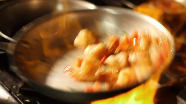 shrimps flip in a skillet over stove. - shrimp seafood stock videos & royalty-free footage