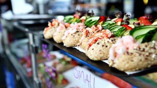 shrimps sandwiches in the fish market of bergen - scandinavian culture stock videos and b-roll footage