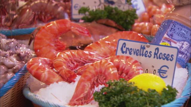 CU PAN Shrimps, sardines, and other seafood on street market stall / Paris, France