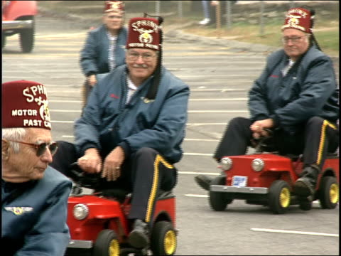 Shriners in Small Cars in Connecticut Parade